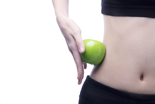 Good healthy body and curve waist and green apple
