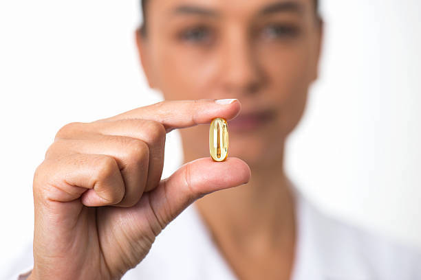 Woman Doctor Holding And Showing Omega 3 Capsule